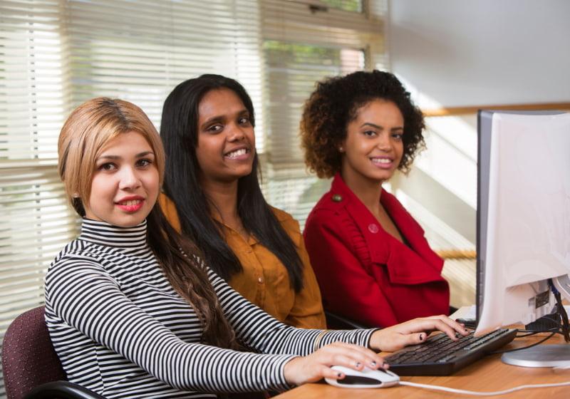 Three aboriginal women working at the office
