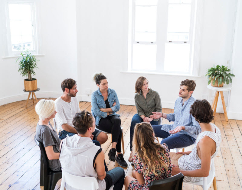 Group of people gathered and discussing