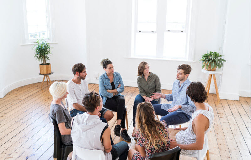 Man talking in a group counselling session