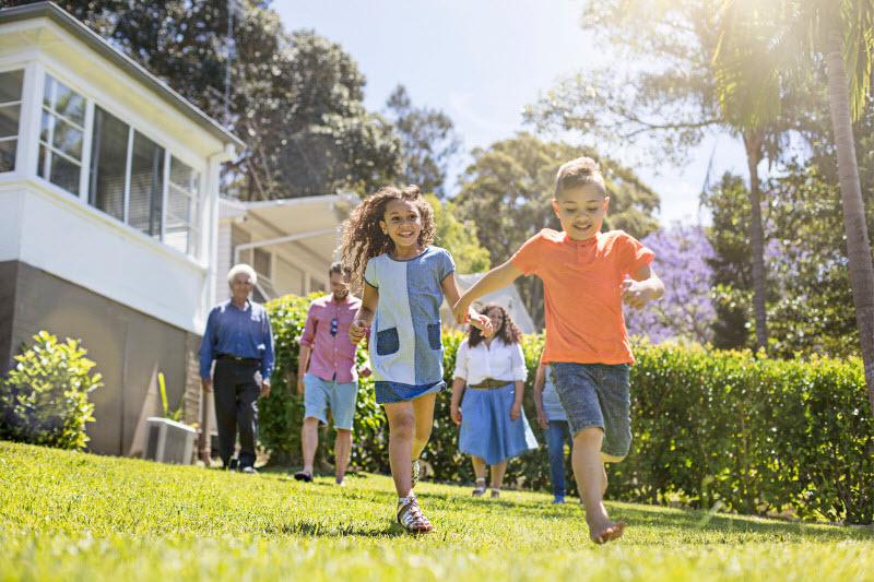 Happy Aboriginal family playing at the backyard