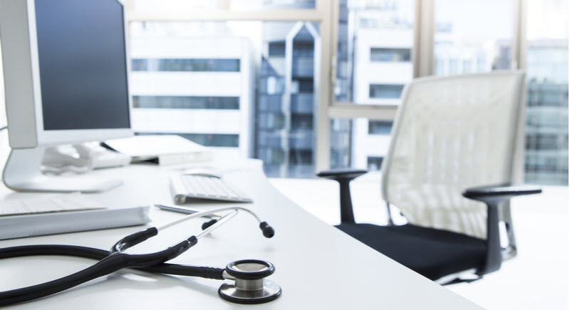 Empty table of a doctor with a stethoscope
